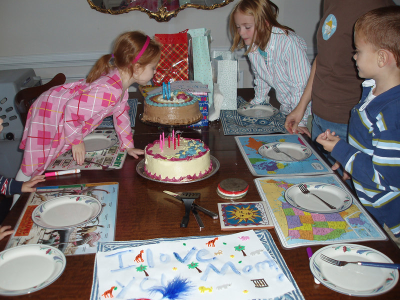 Helping Holly blow out the candles.