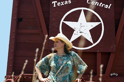 These photos of Michelle were taken west of Albany, TX next to a railroad livestock car at the historic Bud Matthews Switch and Stockyards.  West Texas can bring out the cowgirl or cowboy in anyone with its large ranches and open range.