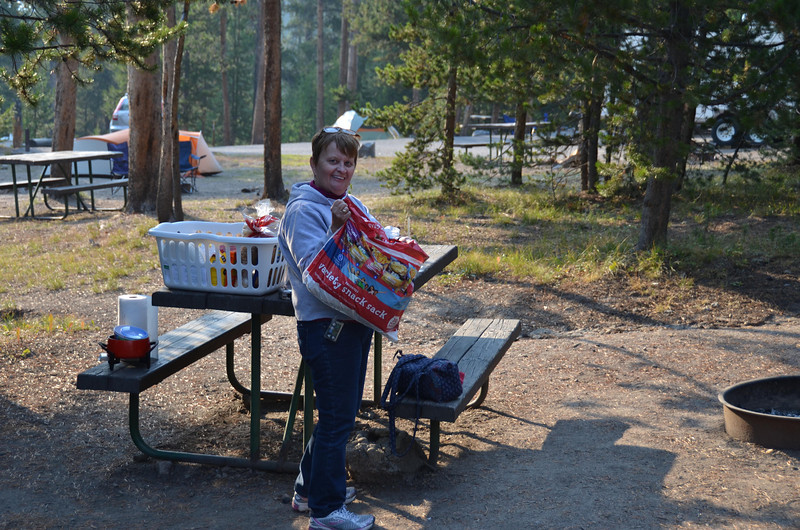 Mom with snack bag at Yellowstone campground.  Got below freezing for couple nights but we were snug as can been in the Jeep.  Food was tasty.