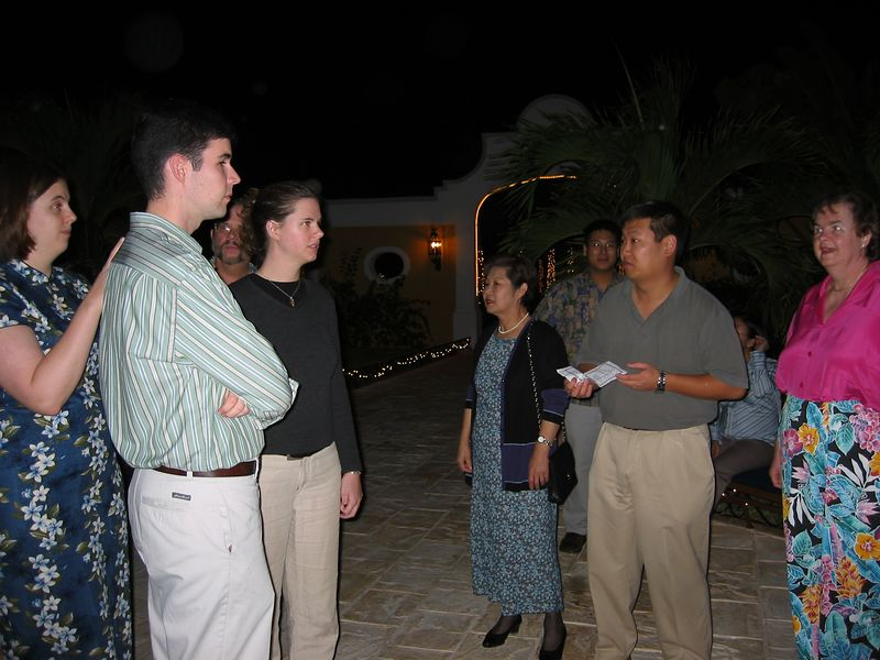 Chris gives out room assignments on arrival at the Sunscape Hotel near Tulum.  From the left, we see Katie, Jim, Dick(in background), Liz, Sandy, Solomon (in background), Chris and Susan.