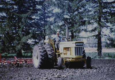 Grandpa never stopped driving tractors