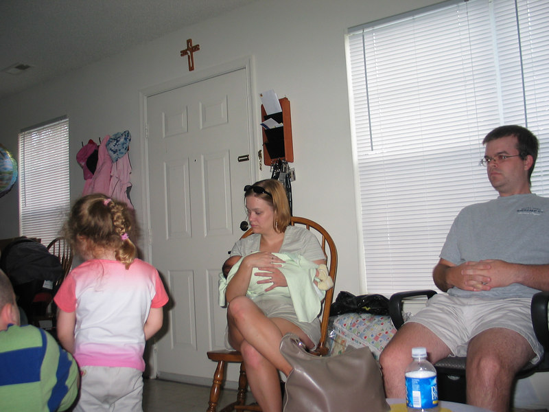 Amy holds Carson.  Christina's brother watches Britney.