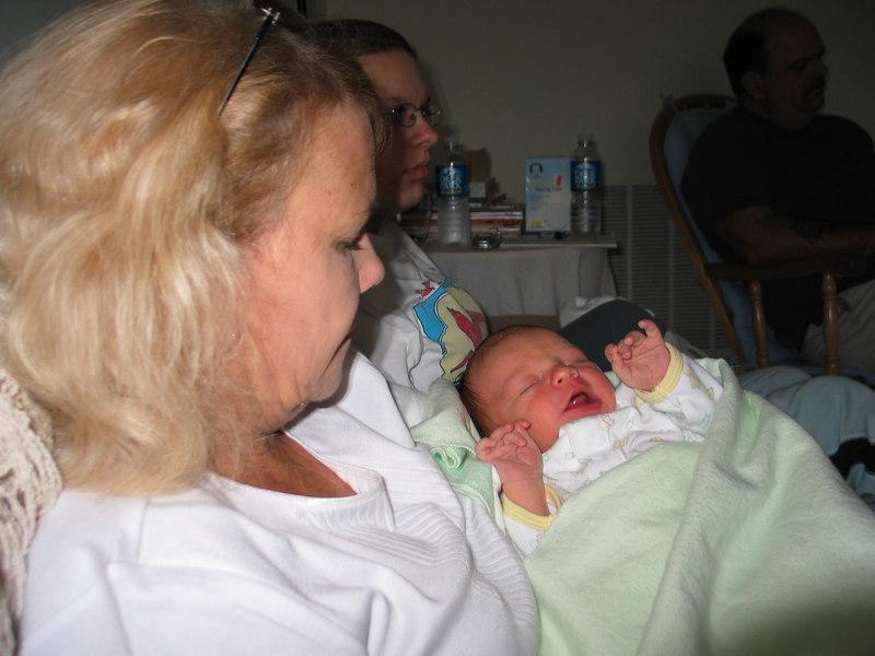 Grandma Sharon holding Carson Tyler Whitmore....new grandson.  New Mom Christina Whitmore hids behind new Grandma.