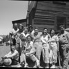 This likely the Bergschneider family, including brothers and sisters or other relatives of both John Bergschneider and his wife Addie Bergschneider. Parky Parkhouse is second from the left, top row.