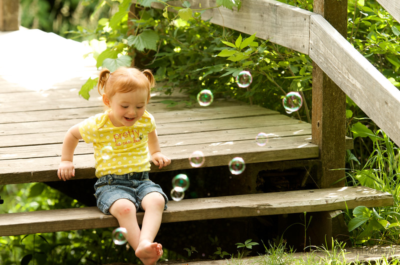 Sunshine, toes, bubbles & the cutest little redhead....