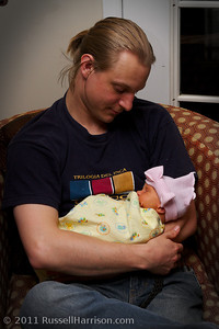 Matt holds his niece for the first time.