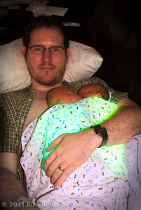"""They had to wear these """"BilliBlankets"""" which are basically fiber optic sheets you wrap around them to expose their skin to light.  It helps them with their jaundice until they're able to process it out on their own.  Judy referred to this shot as an example of our """"nuclear"""" family."""