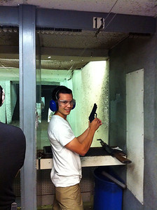 gun range shooting a handgun. Fun while it lasted but no way would I carry one of those around