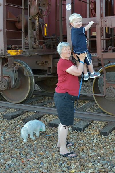2012 Carol helps Will climb on a train
