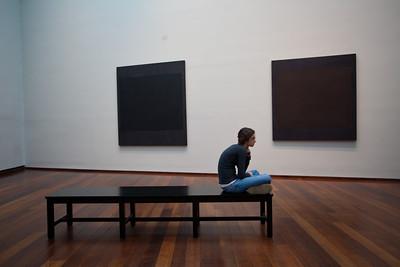 Anisa ponders the black paintings.