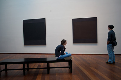 Both Anisa and Jeff ponder the black paintings.