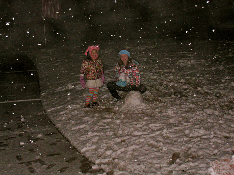 February 11, 2010, 8:30 pm  It rained/snowed all day, but as the sun went down, things started getting colder and the snow was accumulating!  Vanessa and Vivian just can't stand it and head for the front yard to play.