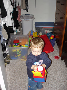 Mom put a bunch of my toys in the closet. I found them and took them back out.