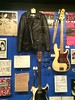 Ramones jacket, bass, drum sticks, and guitar
