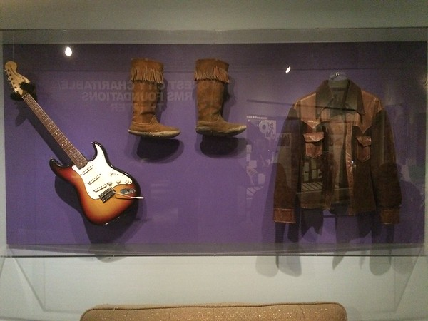 Jimi Hendrix guitar, boots, and jacket