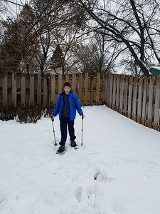 Leo tries snowshoeing in the backyard