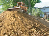 skid steer on top of dirt dug from basements