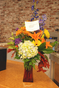 Flowers and congratulations from well-wishers.