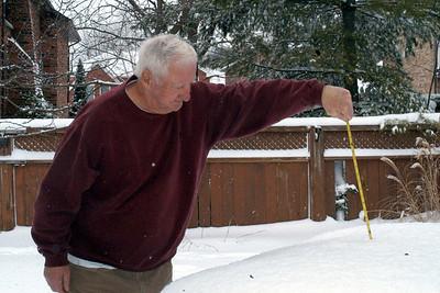 """Grampie measures the snowfall at 14"""""""