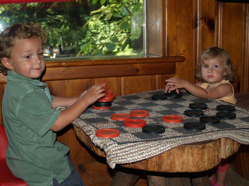 Xavier & Zara with checkers while waiting for the Lost River Caverns Tour