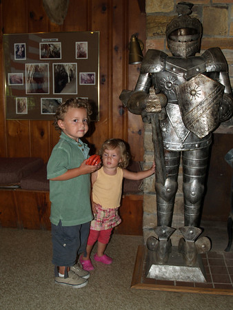 Kids with guy in suit of armor; lobby of Lost River Caverns