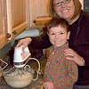 Paul and his mom making a cake for Grampie's birthday.