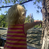 Kenna the intrepid climber... in a tree fort 8 feet above the ground.  (Note Poppa's hand keeping a firm grip on her pants.)