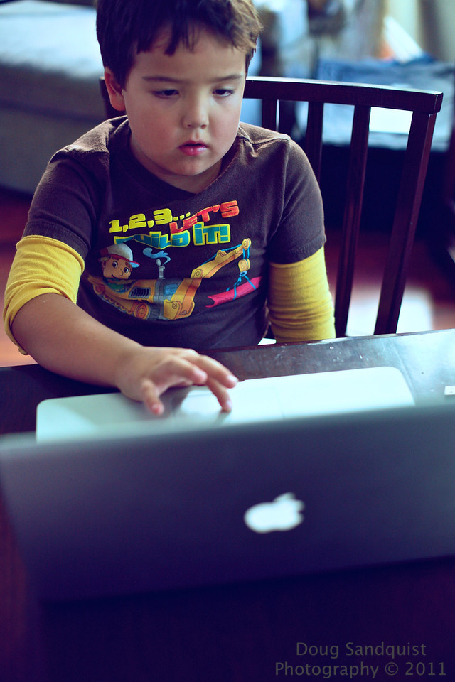 it looks like he's working hard on the laptop... and it is working hard playing a game! :)<br /> <br /> 09-02-2011