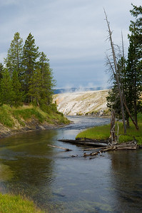 Firehole River near Old Faithful (geyser steam in the background)