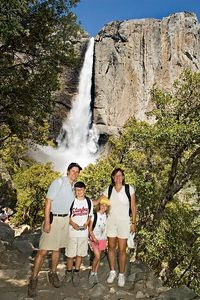 We finally reach the point where we could see the upper falls and, in one of those rare photos with John in it, we grabbed a stranger to get a picture of all four of us.  The view of the upper falls was simply spectacular.  This is the largest waterfall in North America and the 4th largest in the world.  The sound of the falls was incredibly loud too.