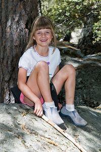 Sara climbing on some granite boulders.
