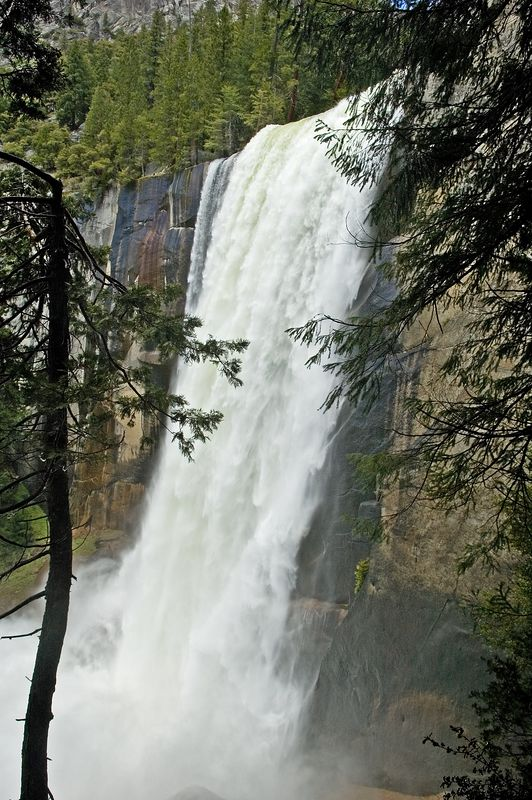 "This is a close-up view of Vernal Falls.  Like all the other falls, there was a ton of mist in the air and we got completely drenched climbing past the base of the falls.  If you haven't done this hike, it's hundreds of stairs carved out of the rock.  The trail is appropriately called the ""mist trail"".  On a normal summer day, you'd probably enjoy a little cooling mist.  On this day, we got drenched."
