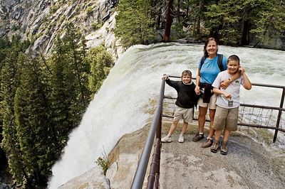Here we are at the top of Vernal Falls.  You can see the water going over the edge and can probably see how wet everyone is from the climb.
