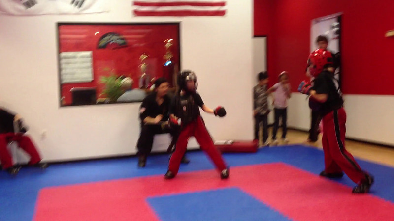Zachy sparring for his novice black belt