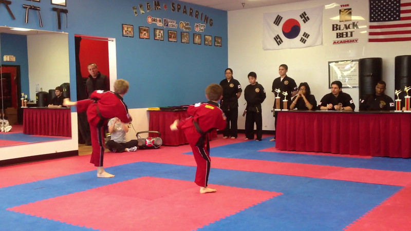 Zachy doing his combinations and forms for his novice black belt graduation.