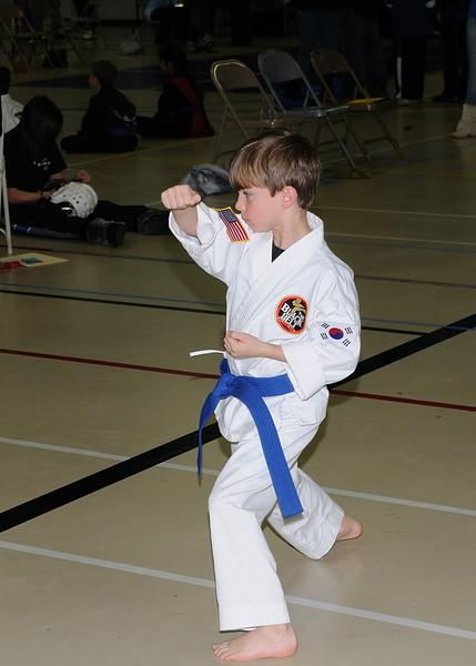 Zach doing his purple belt form.