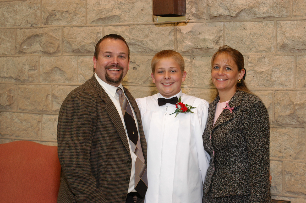 Zak with his mom and dad.