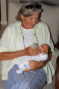 Betsy Morris feeds the baby