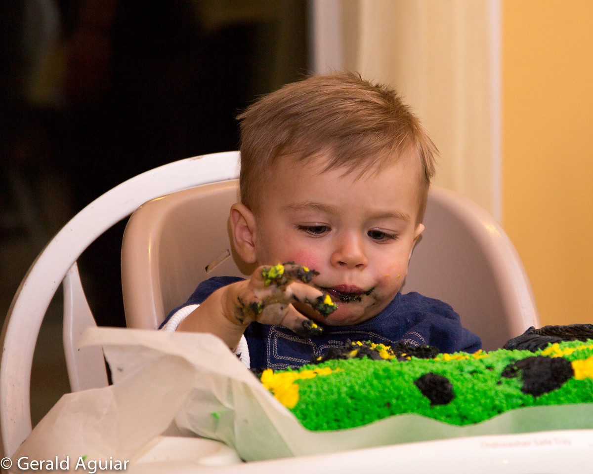 Zane getting into eating the cake.