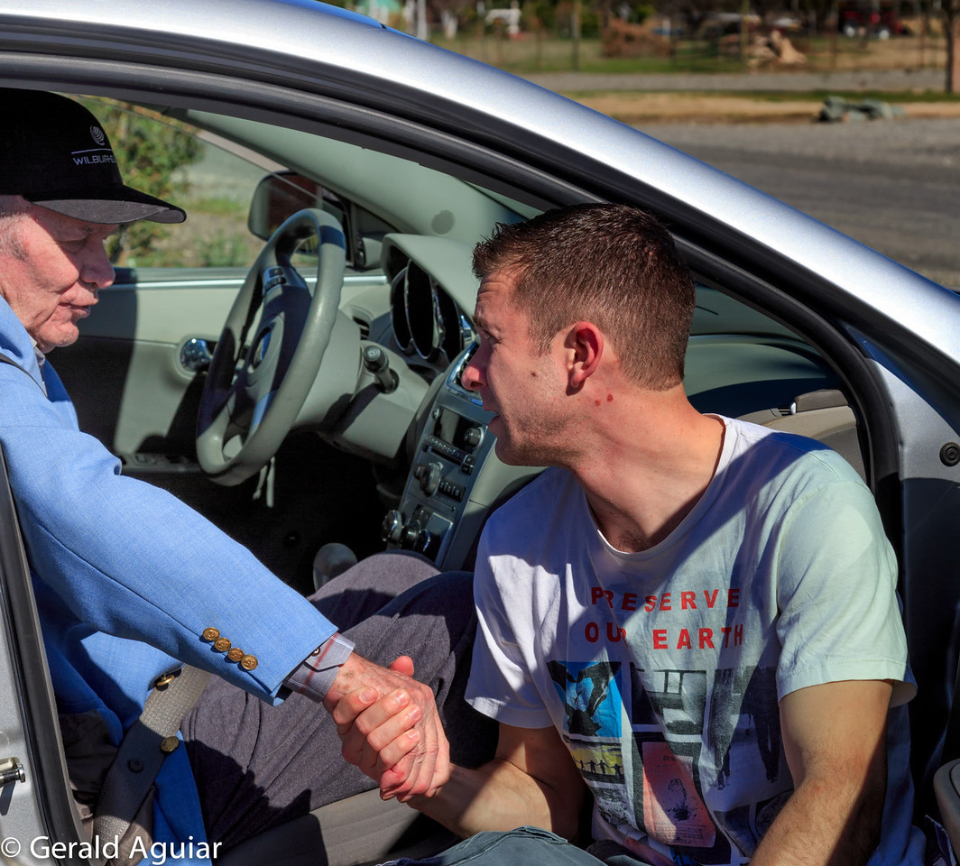 Brian and Grandpa Joe talking to one another in the car in front of Kristin's house.