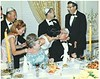 """Kissing at the table""<br /> Arthur Zimmerman, Alice Zimmerman, Anna Zimmerman, Norie Zimmermasn(kissing Art), Hersh Zimmerman, Jacob Zimmerman & Herb Zimmerman<br /> <br /> 50th Wedding Anniversary Party, Fairmont Hotel, San Francisco, 1967"