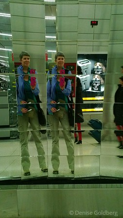 fractured... an image of one of me reflected in mirrors at Logan Airport Terminal C
