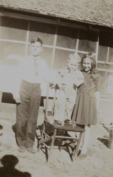 Odell Henderson Huff and Alice Geneva Huff with Lydia Matilda Huff's son, Wayne