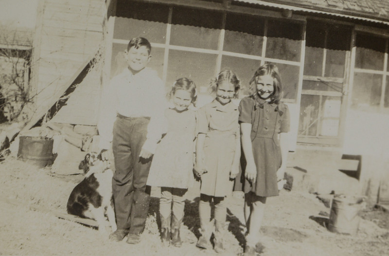 From Right to Left: Alice Geneva Huff, Evelyn Elva Huff, Sylvia Genevieve Huff, and Odell Henderson Huff with dog, Jack