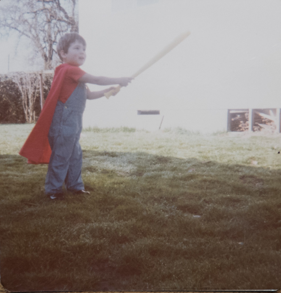 Jeremy, 3 and a half years old, playing baseball with Bill Dobbins, 1979.