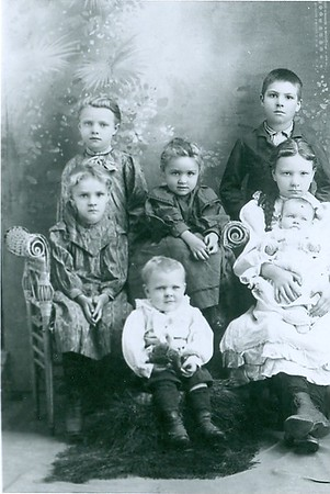 Godwin family. The girl holding the baby is Martha Vaughn (née Godwin) and became Crystal Pearce's (née Vaughn's) mother.