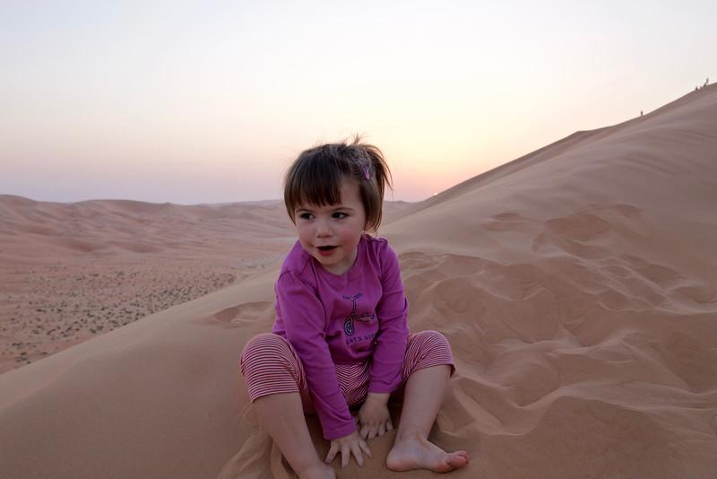Anahita stops to play as the sun sinks lower.
