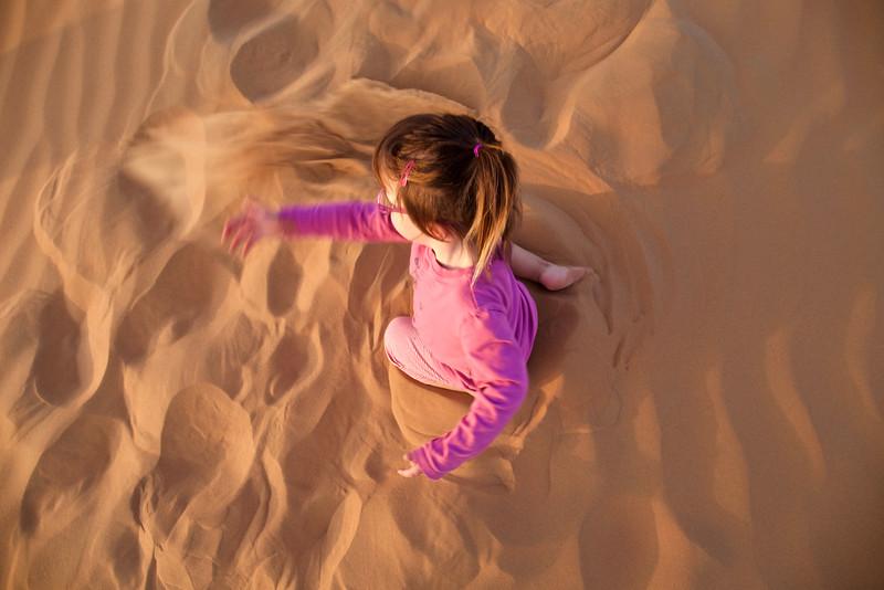 Anahita swirls around, throwing sand in an arc.