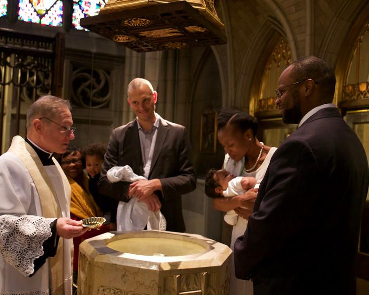 Father Joe addresses Siani Kayani, Masha's godfather.