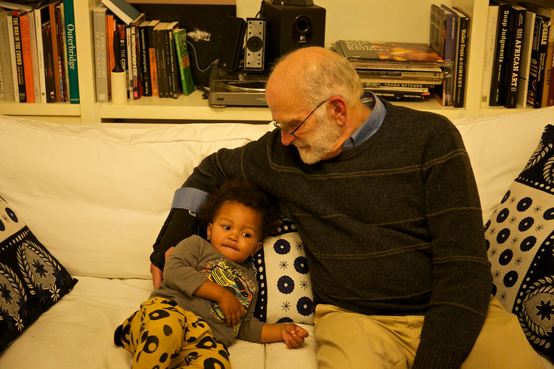 On the sofa with Grandpa.